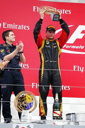 Kimi Raikkonen, Lotus F1 Team celebrates his second position on the podium