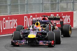 Sebastian Vettel, Red Bull Racing RB9 et Kimi Räikkönen, Lotus F1 E21