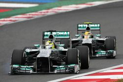 Nico Rosberg, Mercedes AMG F1 W04 with a loose front wing, leads team mate Lewis Hamilton, Mercedes