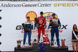Race winner Scott Dixon, second place Simona de Silvestro, third place Justin Wilson