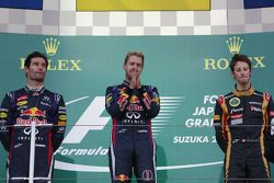 The podium: Mark Webber, Red Bull Racing, second; Sebastian Vettel, Red Bull Racing, race winner; Ro