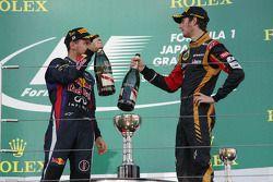 Sebastian Vettel, Red Bull Racing et Romain Grosjean, Lotus F1 Team