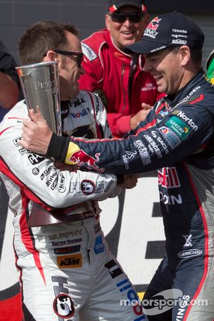 Craig Lowndes pretends to wrestle Greg Murphy for the Peter Brock trophy