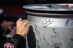 A wheel is being signed