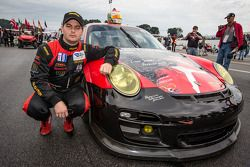Henrique Cisneros, friend and co-driver of Sean Edwards, with the #30 NGT Motorsport Porsche 911 GT3 Cup with the Sean Edwards memorial livery
