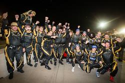 Race winners Nick Heidfeld, Neel Jani and Nicolas Prost celebrate with Rebellion Racing team members