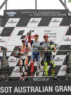 Podium: race winner Jorge Lorenzo, second place Dani Pedrosa, third place Valentino Rossi