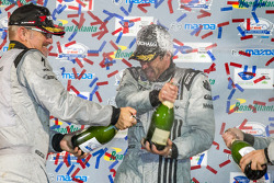 GTC podium: champagne for Joe Foster and Patrick Dempsey