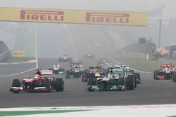 Felipe Massa, Ferrari F138 and Nico Rosberg, Mercedes AMG F1 W04 at the start of the race