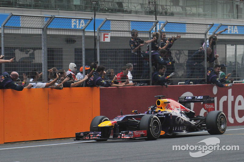 Race winner and World Champion Sebastian Vettel, Red Bull Racing RB9 celebrates at the end of the race