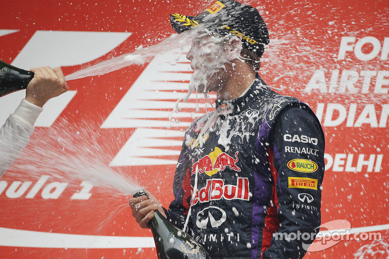 Race winner and World Champion Sebastian Vettel, Red Bull Racing celebrates with the champagne on th