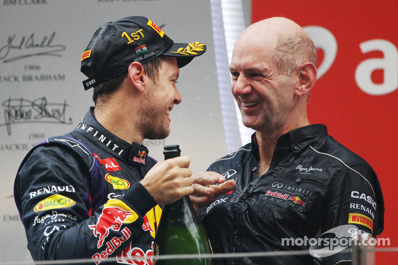Race winner and World Champion Sebastian Vettel, Red Bull Racing celebrates on the podium with Adrian Newey, Red Bull Racing Chief Technical Officer