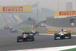 Romain Grosjean, Lotus F1 Team and Adrian Sutil, Sahara Force India F1 Team