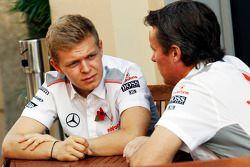 (L to R): Kevin Magnussen, McLaren Test Driver with Sam Michael, McLaren Sporting Director