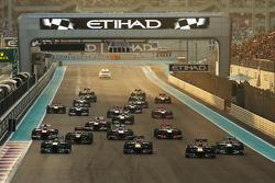 Mark Webber, Red Bull Racing RB9 is passed by team mate Sebastian Vettel, Red Bull Racing RB9 at the start of the race