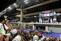 Photographers shoot the podium