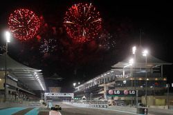 Charles Pic, Caterham CT03 finishes as fireworks fly over the circuit.
