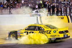 Joey Logano celebrates NASCAR Nationwide Series 2013 car owner championship by Roger Penske
