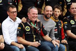 (L to R): Eric Lux, Genii Capital CEO; Gerard Lopez, Genii Capital; Romain Grosjean, Lotus F1 Team at a team photograph
