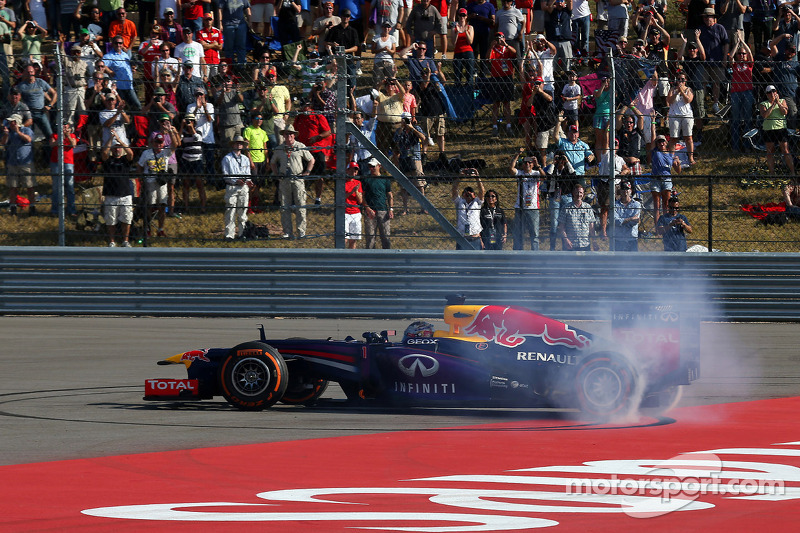 Race winner Sebastian Vettel, Red Bull Racing RB9 celebrates at the end of the race with some doughn