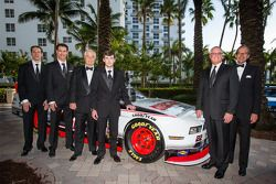 NASCAR Nationwide Series champion owner Roger Penske poses with drivers Brad Keselowski, Ryan Blaney