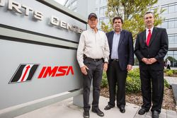 IMSA CEO Ed Bennett, IMSA and International Speedway Corporation (ISC) Chairman Jim France and NASCAR President Mike Helton unveil the addition of IMSA logos to signage outside the eight-story IMC building that is headquarters to IMSA, NASCAR and ISC