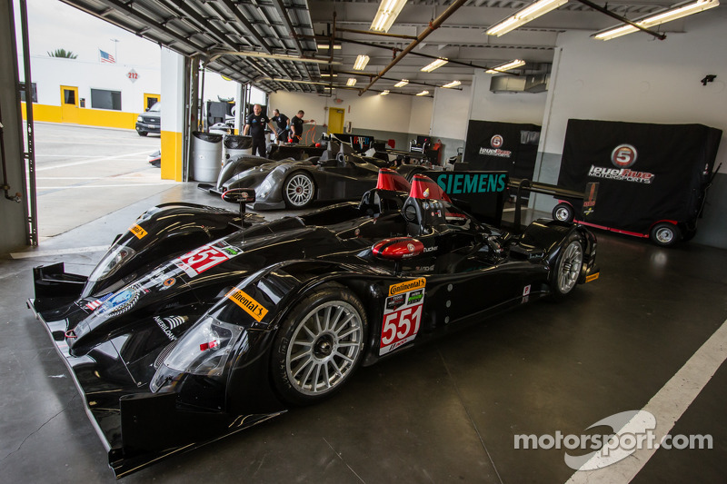 Level 5 cars on display in the garage