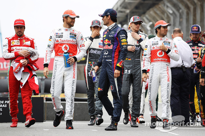Jenson Button, McLaren y Mark Webber, Red Bull Racing