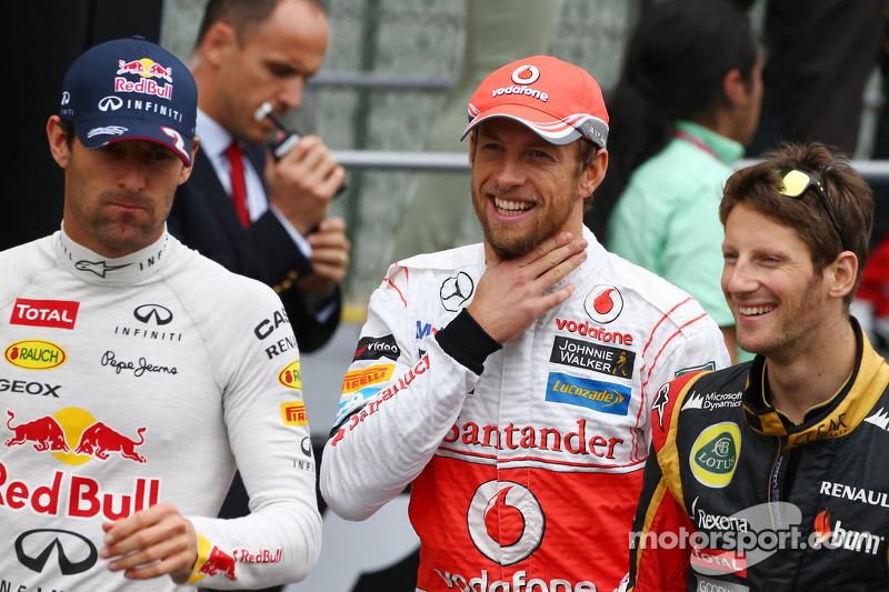 Mark Webber, Red Bull Racing; Jenson Button, McLaren; y Romain Grosjean, Lotus F1 Team