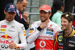 Mark Webber, Red Bull Racing; Jenson Button, McLaren; y Romain Grosjean, Lotus F1 Team