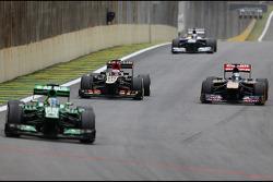 Heikki Kovalainen, Lotus F1 Team and Jean-Eric Vergne, Scuderia Toro Rosso
