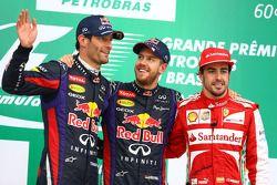 The podium: Mark Webber, Red Bull Racing, second; Sebastian Vettel, Red Bull Racing, race winner; Fernando Alonso, Ferrari, third