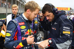 (L to R): Sebastian Vettel, Red Bull Racing with Guillaume Rocquelin, Red Bull Racing Race Engineer on the grid