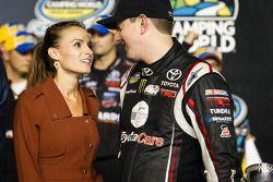 Championship victory lane: NASCAR Camping World Truck Series 2013 champion owner Kyle Busch with wife Samantha Sarcinella