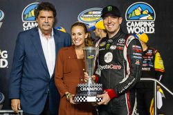 Championship victory lane: NASCAR Camping World Truck Series 2013 champion owner Kyle Busch with wife Samantha Sarcinella and NASCAR President Mike Helton