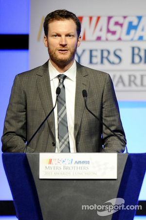 Dale Earnhardt Jr. speaks onstage after winning the Most Popular Driver at the NMPA Myers Brothers Awards Luncheon