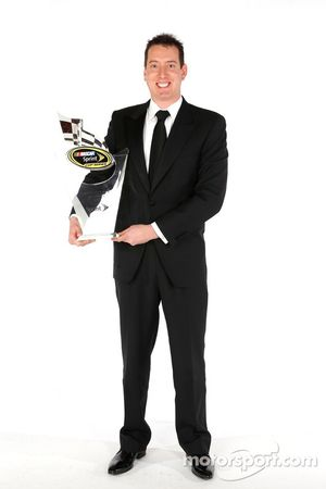 Kyle Busch poses for a portrait with his fourth place trophy