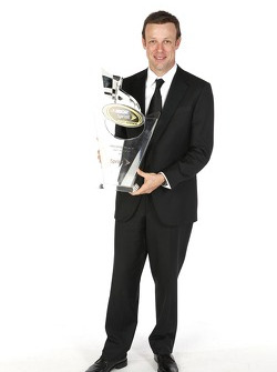 Matt Kenseth poses for a portrait with his second place trophy