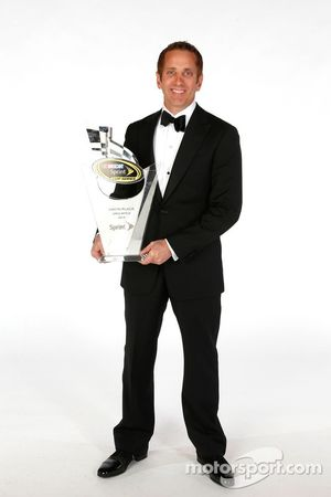 Greg Biffle poses for a portrait with his ninth place trophy