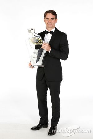 Jeff Gordon poses for a portrait with his sixth place trophy