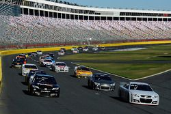 Denny Hamlin, Joe Gibbs Racing Toyota and Kevin Harvick, Stewart-Haas Racing Chevrolet lead a group of cars