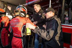 P class and overall pole winner Alex Gurney celebrates with Bob Stallings and Memo Gidley