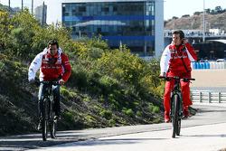 (L to R): Pedro De La Rosa, Ferrari Development Driver cycles the perimiter road with Massimo Rivola, Ferrari Sporting Director
