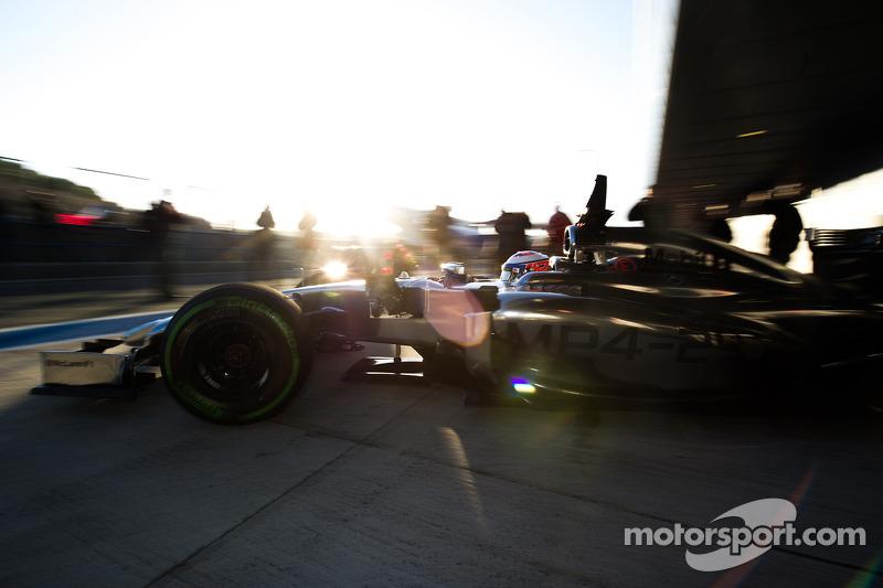Jenson Button, McLaren MP4-29 leaves the pits