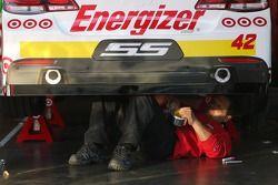 Team members work on the car of Kyle Larson, Ganassi Racing Chevrolet