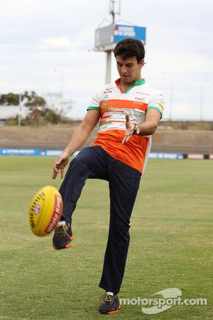 Sergio Perez, Sahara Force India F1 practices his Australian Rules Football skills with the Western