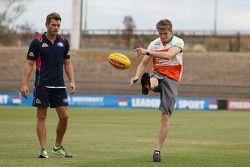 (L to R): Shaun Higgins, Western Bulldogs Australian Rules Footballer with Nico Hulkenberg, Sahara F
