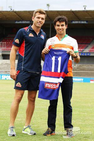 (L to R): Shaun Higgins, Western Bulldogs Australian Rules Footballer presents a team jersey to Serg