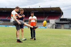 (L to R): Nico Hulkenberg, Sahara Force India F1 practices his Aussie Rules skills with Shaun Higgin