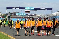 Hi-vis jackets worn as support race teams walk the circuit
